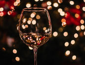 Wine glass with festive lights background