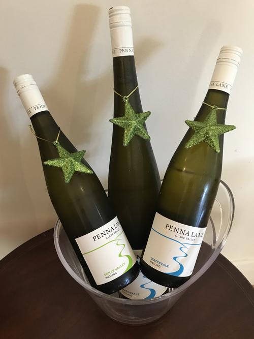 Three bottles of Riesling in a wine bucket, each with a Xmas star