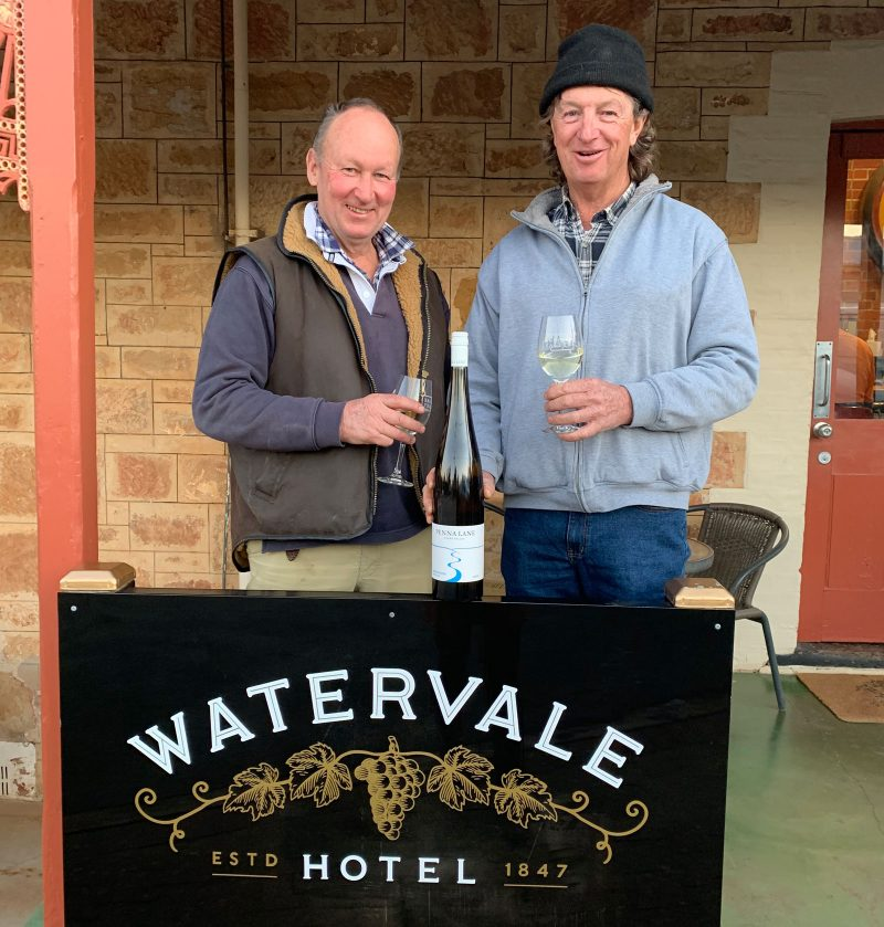 Two men and a bottle of Riesling outside the Watervale Hotel